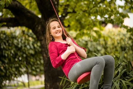 swing: Girl swinging on seesaw
