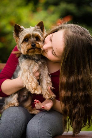 domestic life: Girl hugging with her dog