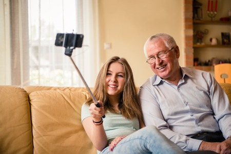 grandchild: Grandfather with grandchild selfie Stock Photo