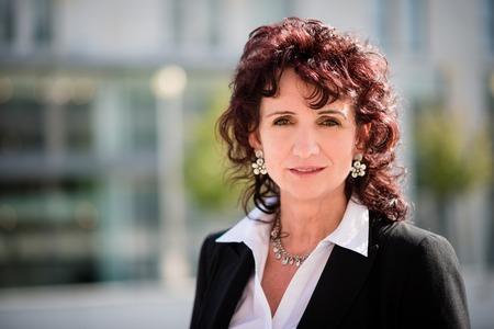 Portrait of confident senior business woman outdoor in street Standard-Bild