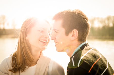tenager: Young happy couple looking on each other  - outdoor lifestyle portrait