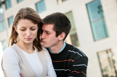 Relationship problems - man trying to reconcile with offended woman photo