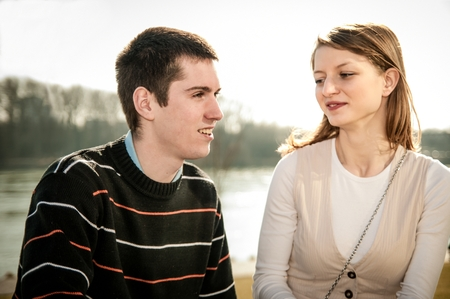 Young happy couple together  - outdoor lifestyle portrait photo