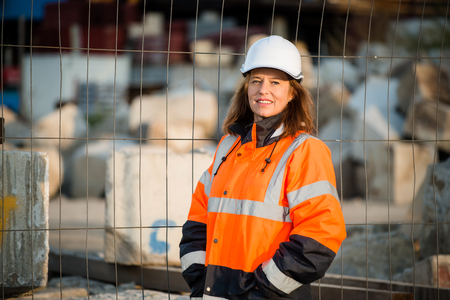 Portrait of senior woman engineer wearing protective workwear in work Stock Photo