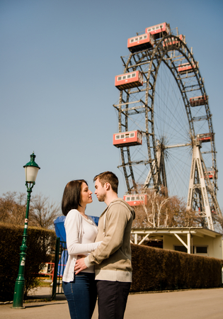 prater: Vienna, Prater - couple embracing and hugging  in front of ferris wheel