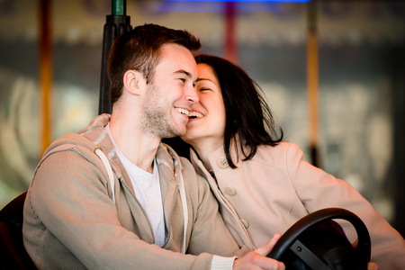 prater: Vienna, Prater - couple dating and riding on carousel car in entertainment park
