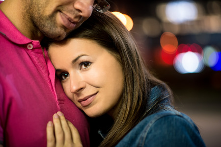 romantic date: Romantic young couple together on date in street at night Stock Photo