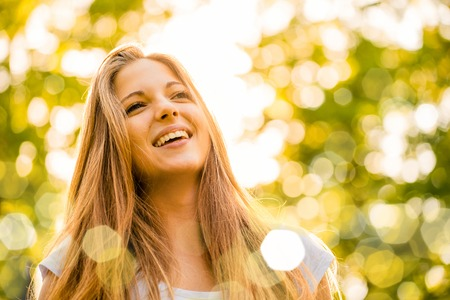 Portrait of young happy smiling teenage girl - outdoor in park