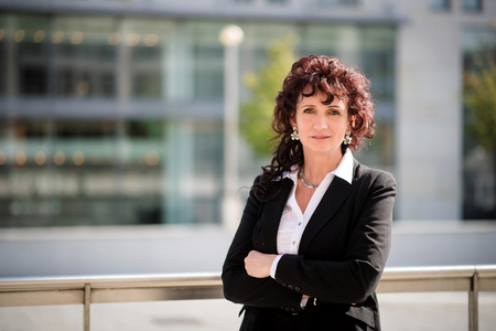 Portrait of confident senior business woman outdoor in street
