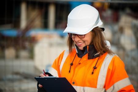 vest: Senior woman engineer wearing protective workwear at work