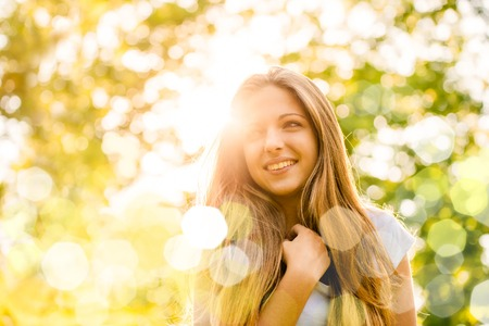 Portrait of young happy smiling woman - outdoor in nature
