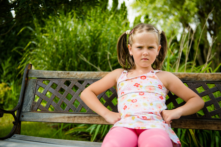cheeky: Portrait of small offended child - outoor in backyard Stock Photo