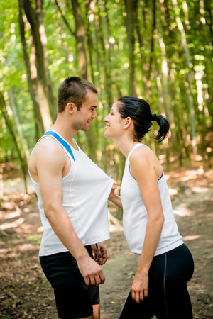 tenager: Sport couple together in nature having great time Stock Photo