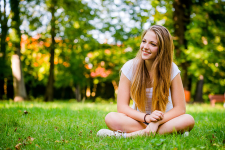 Young beautiful woman (teen girl) looking to side - outdoor in nature Stock Photo