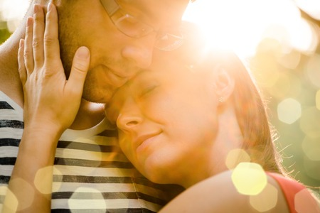 intimate: Intimate moments - young couple embracing and hugging in nature Stock Photo
