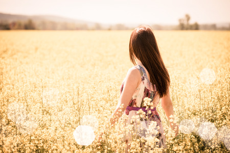 Young woman in rapeseed field photo
