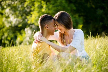 grassfield: Romantic moments - couple looking to eyes Stock Photo