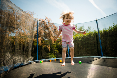 Child jumping trampoline Banque d'images
