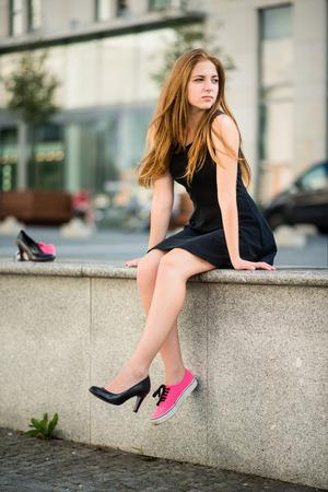 Shoe dilemma - sneakers versus high heels Stock Photo