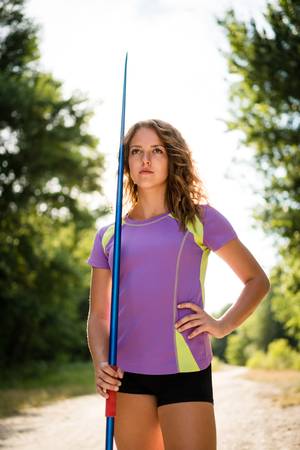 pink skies: Athlete with javelin portrait Stock Photo