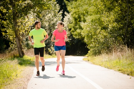 Couple running and talking together photo