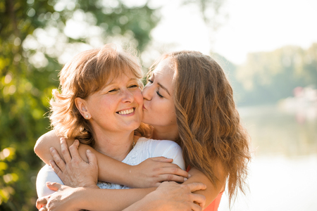 Happy together - mother and teenage daughter outdoor Banco de Imagens