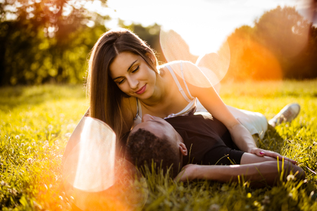 Outdoor romance - young couple hugging