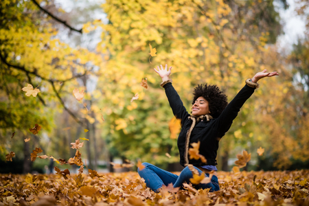 Woman united with nature in autumn Stockfoto