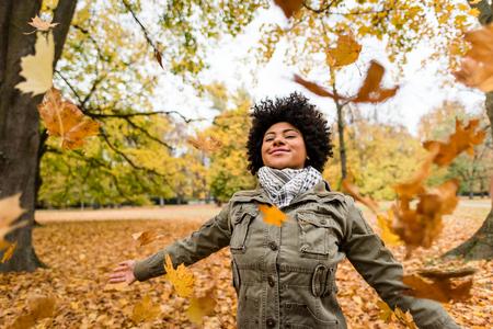 Smiling woman enjoying fall season Stock Photo