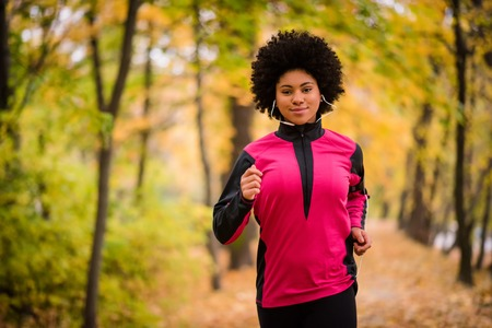 Teen jogger girl exercising while tuned to music