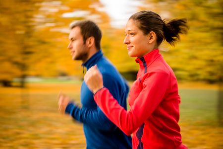 Couple jogging in nature - motion blur