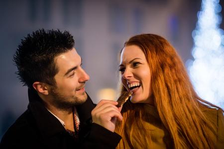 Sweet love - couple eating chocolate