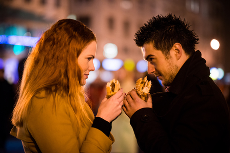 Duel - eating together in street Stock Photo