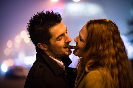 Proximity alert - couple eating one piece of chocolate Reklamní fotografie - 90546505