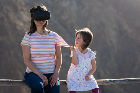 Virtual reality - mother and girl 写真素材
