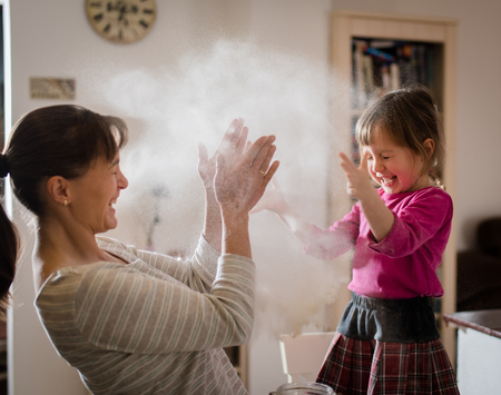 Mother with daughter having fun by baking Stock Photo