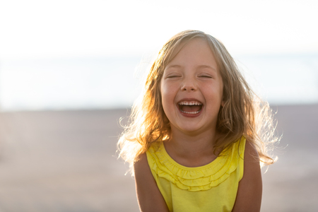 Carefree girl child laughing with eyes closed Reklamní fotografie