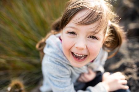 Headshot of cute little girl laughing