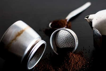 Ingredients for making moka coffee. Moka pot with coffee on dark background. Coffee making concept. 版權商用圖片