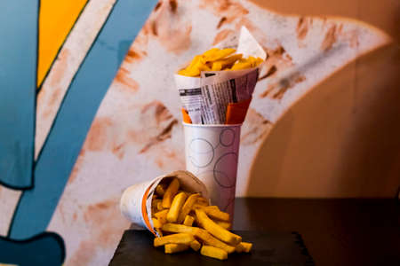 Double pack of Fresh French fries, deep fried Homemade Baked potato chips. Typical dutch fried food.