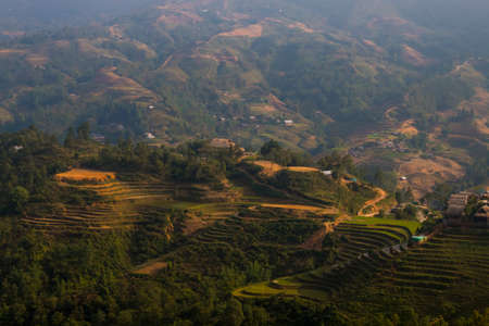 Vietnam landscape with rice field, river, mountain and low clouds in early foggy morning in Trung Khanh, Cao Bang, Vietnam.