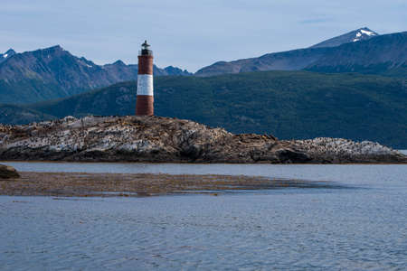 Bird Island in the Beagle Channel near the Ushuaia city. Ushuaia is the capital of Tierra del Fuego province in Argentina. Place full of birds and pinguin next to a lighthouse.