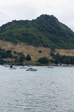 Tauranga, New Zealand: 09/07/2018: The bay and harbor at Tauranga with calm water in front of the Mount Editorial