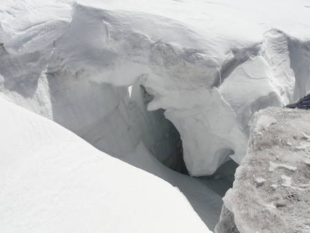 crevasse: Snow Bridge over crevasse on Grossvenediger Stock Photo