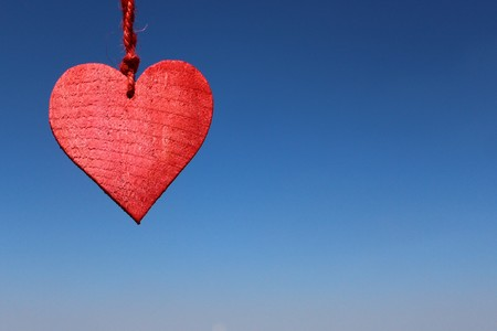 Red heart in front of blue sky