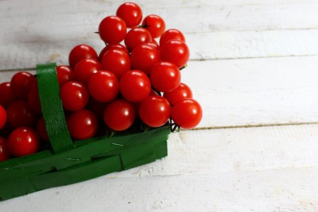 Tomatoes in a green basket