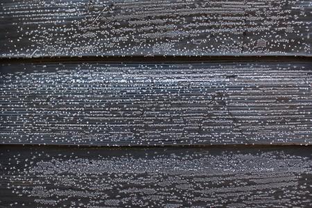 black boards on hoar frost