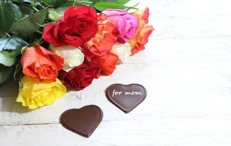 Colorful roses and chocolate hearts for mother`s day Stok Fotoğraf