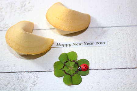 fortune cookies with the text happy new year
