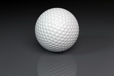 A white golfball on slightly reflective gray background